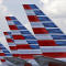 The tails of four American Airlines passenger planes are seen at Miami International Airport in Miami on July 17, 2015.