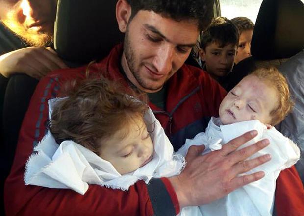 syria-chemical-khan-sheikhoun-twins-ap-17095555756920.jpg