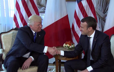 Trump and Macron share long handshake