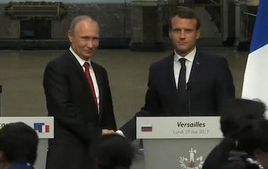 Macron attacks Russian media outlets while standing near Putin