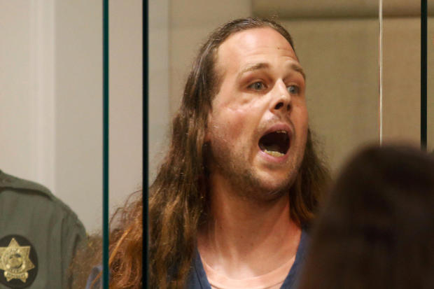 A convicted felon, Jeremy Christian, 35, accused of fatally stabbing two Good Samaritans who tried to stop Christian from harassing a pair of women who appeared to be Muslim, shouts during an appearance in Multnomah County Circuit Court in Portland, Orego