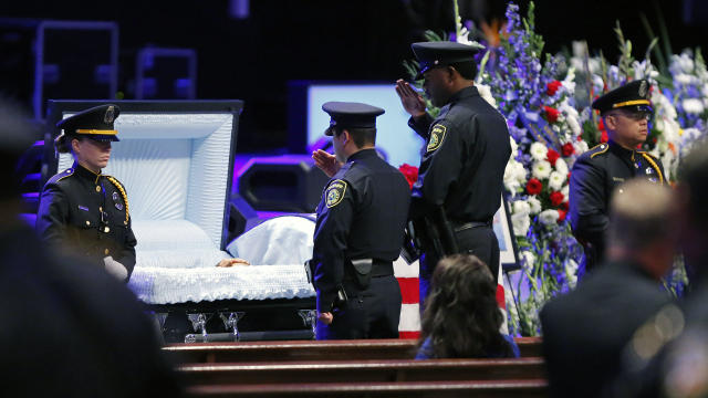 Law enforcement pay respects during a viewing before the funeral service for Dallas Police Senior Cpl. Lorne Ahrens held at Prestonwood Baptist Church on July 13, 2016, in Plano, Texas.
