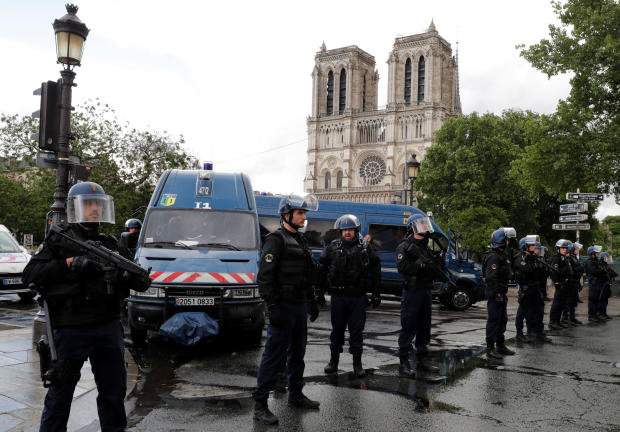 French police stand at the scene of a shooting incident near the Notre Dame Cathedral in Paris, France, June 6, 2017.