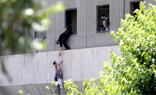 child-man-rescue-iran-tehran-attack.jpg