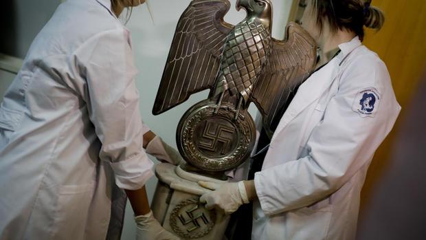 Trove of suspected Nazi artifacts found in hidden room