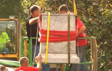 Workers discover time capsule inside Confederate statue