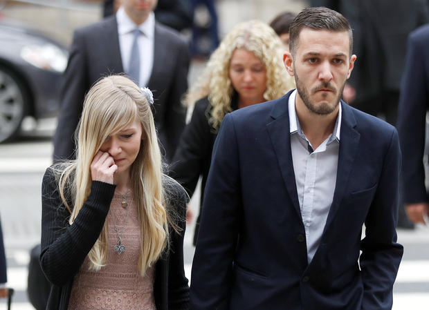 Charlie Gard's parents Connie Yates and Chris Gard arrive at the High Court ahead of a hearing on their baby's future, in London, Britain, July 24, 2017.