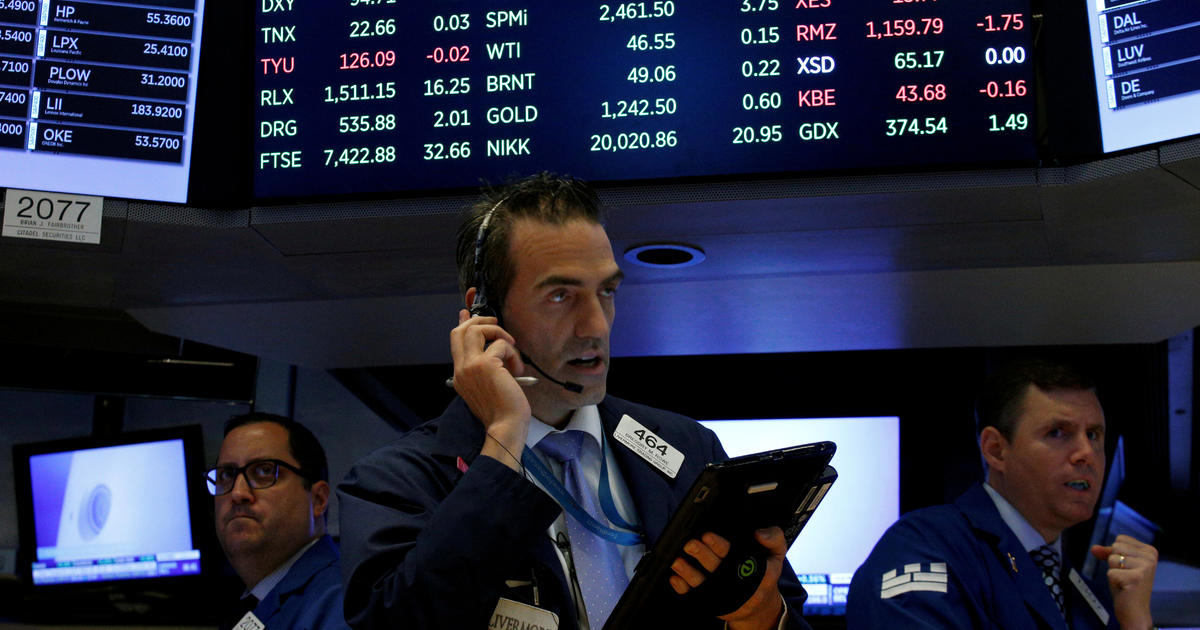 Dow closes above 22,000 for the first time - CBS News