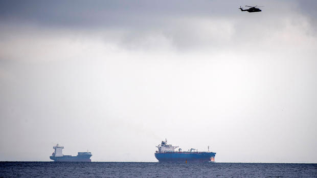 A helicopter searches the area off of Copenhagen Harbour where the Nautilus, considered the largest privately built submarine of its kind, was reported missing near Copenhagen, Denmark, Aug. 11, 2017.