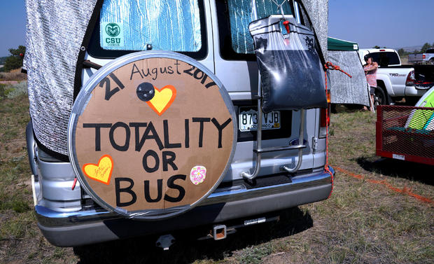 A minibus parked in a designated eclipse viewing area is seen in a campground near Guernsey
