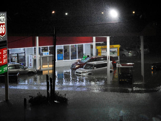 Cars sit abandoned at a flooded gas station after Hurricane Harvey made landfall on the Texas Gulf coast and brought heavy rain to the region