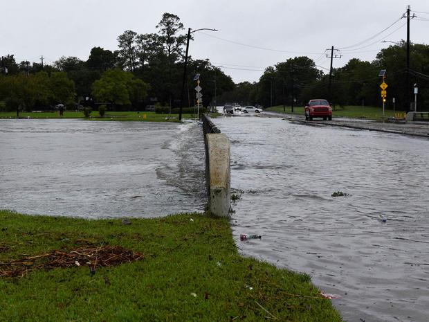 Brays Bayou flows over a bridge after Hurricane Harvey inundated the Texas Gulf coast with rain causing widespread flooding