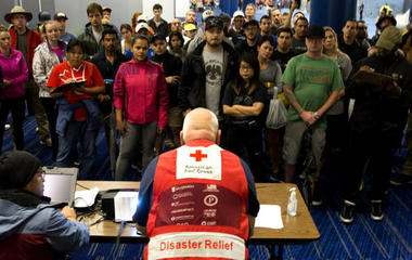 Thousands fill crowded Houston shelters as rescues continue