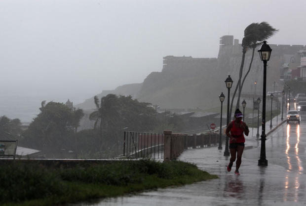 A woman runs in the rain as Hurricane Irma slammed across islands in the northern Caribbean on Wednesday, in San Juan