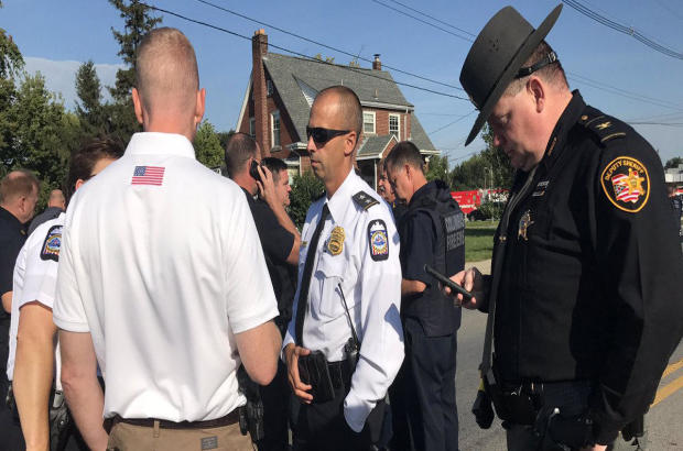 Authorities meet following a report of a shooter at Scioto High School in Columbus, Ohio, on Sept. 8, 2017.