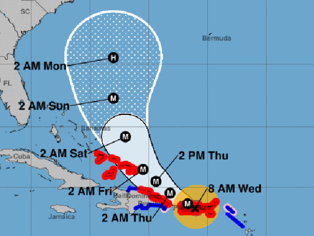 """A map shows the probable path for Hurricane Maria as of 8 a.m. ET on Sept. 20, 2017. The M stands for """"major hurricane."""" The red areas represent hurricane warnings. The blue areas represent tropical storm warnings."""