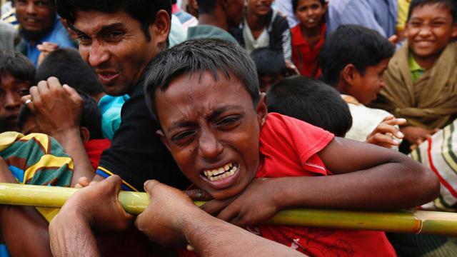 A Rohingya refugee boy jostles for aid in Cox's Bazar