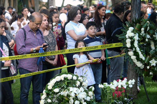 Family members and friends of children and grown-ups who died after their school collapsed in an earthquake attend a Mass in Mexico City, Mexico, Sept. 24, 2017.