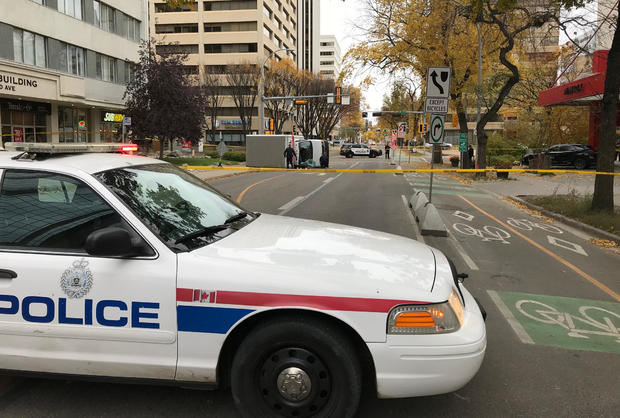 Edmonton Police investigate at the scene where a man hit pedestrians then flipped the U-Haul truck in Edmonton