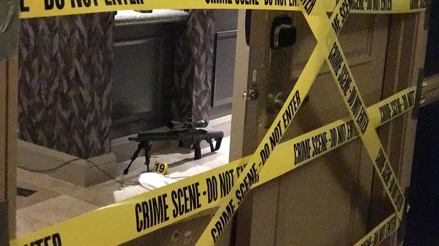 Crime scene tape lines the doors of gunman Stephen Paddock's suite on the 32nd floor of the Mandalay Bay Resort and Casino on the Las Vegas Strip in Las Vegas, Nevada, in this photo obtained by CBS News on Oct. 3, 2017.