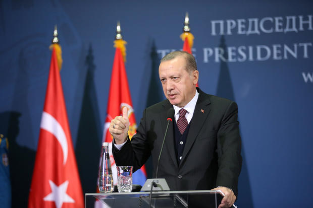 Turkish President Recep Tayyip Erdogan gestures as he speaks during a joint press conference with Serbia's President Aleksandar Vucic after their meeting in Belgrade