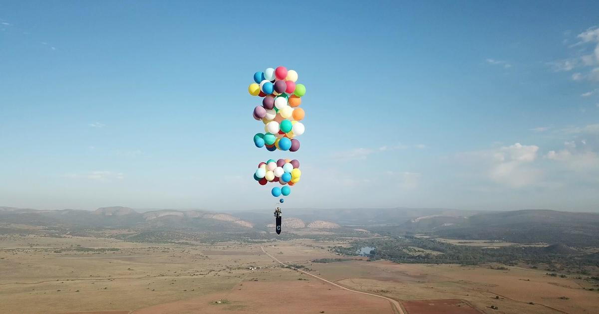 Man strapped to 100 helium balloons flies 8000 feet up in the air man strapped to 100 helium balloons flies 8000 feet up in the air cbs news gumiabroncs Choice Image