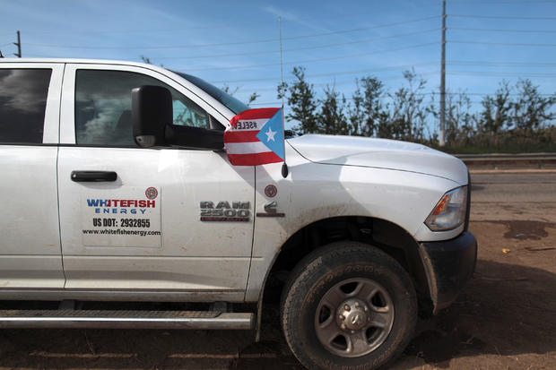A pick up from Montana-based Whitefish Energy Holdings is parked as workers help fix the island's power grid, damaged during Hurricane Maria in September, in Manati