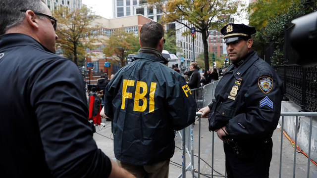 FBI agents enter through a police barricade along Chambers street a day after a man driving a rented pickup truck mowed down pedestrians and cyclists on a bike path alongside the Hudson River in New York City