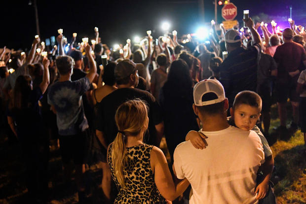 Local residents embrace during a candlelight vigil for victims of a mass shooting in a church in Sutherland Springs, Texas
