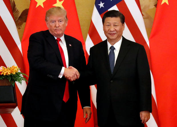 U.S. President Donald Trump and China's President Xi Jinping make joint statements at the Great Hall of the People in Beijing