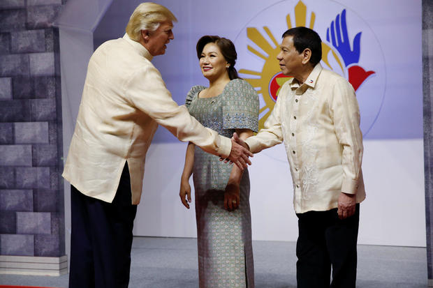 U.S. President Donald Trump shakes hands with Philippines President Rodrigo Duterte as he arrives for the gala dinner marking ASEAN's 50th anniversary in Manila