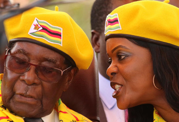 FILE PHOTO: President Robert Mugabe listens to his wife Grace Mugabe at a rally of his ruling ZANU(PF) party in Harare