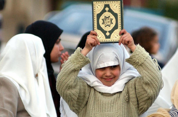 A Jordanian girl hold up the Muslim holy