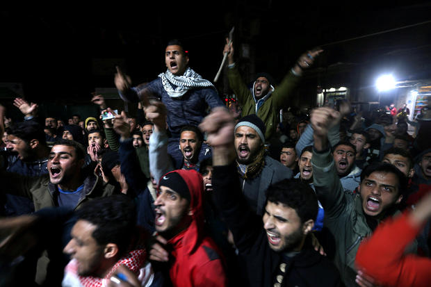 Palestinians react during a protest against Trump's decision to recognise Jerusalem as Israel's capital, in Khan Younis in the southern Gaza Strip