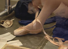 dancer-tying-pointe-shoe-promo.jpg