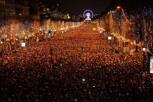 paris happy new year celebrations around the globe pictures cbs news
