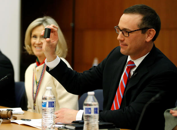 Chairman of the Virginia Department of Elections hold up a film canister containing the name of the winner of a random drawing to determine the winner of the 94th House of Delegates District Seat in Richmond, Virginia