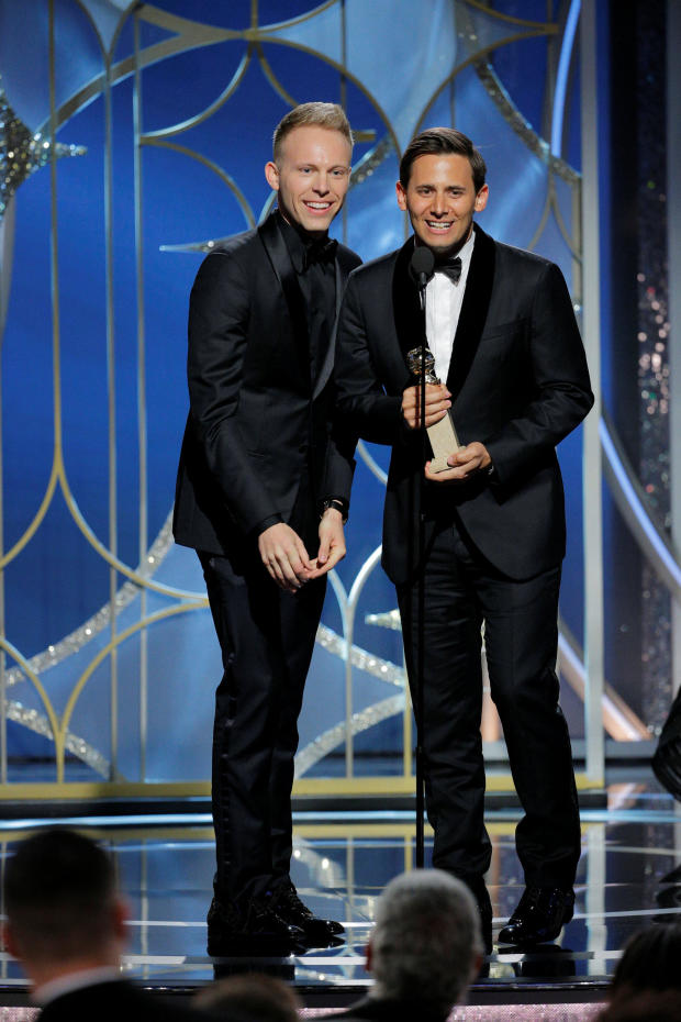 """Justin Paul and Benj Pasek accept the award for Best Original Song Motion Picture for """"This Is Me, The Greatest Showman"""" at the 75th Golden Globe Awards in Beverly Hills"""