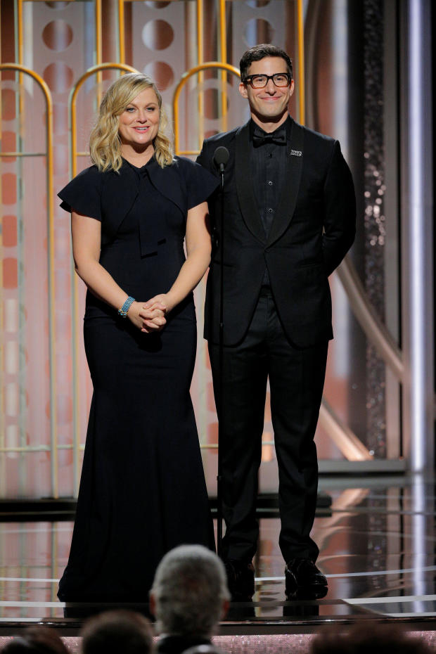 Presenters Amy Poelher and Andy Samberg at the 75th Golden Globe Awards in Beverly Hills, California
