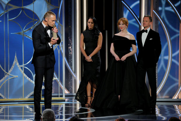 """Alexander Skarsgaard kisses his award for  Best Performance by an Actor in a Supporting Role in a Series, Limited Series, or Motion Picture Made for Television for """"Big Little Lies"""" at the 75th Golden Globe Awards in Beverly Hills, California"""