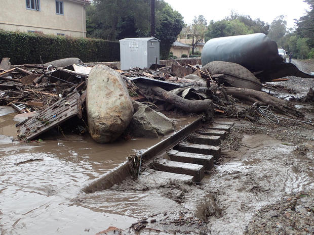 A section of the Union Pacific Railroad is blocked by mudflow and debris after a mudslide in Montecito