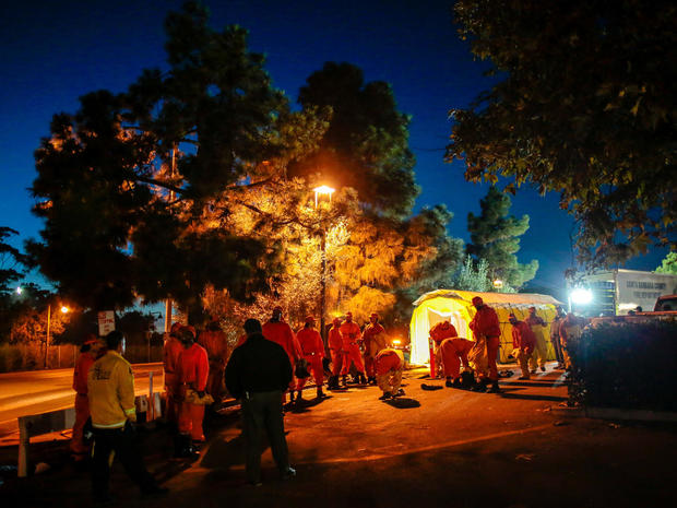 California Department of Corrections and Rehabilitation prisoners exit a shower tent used by rescue workers after a mudslide in Santa Barbara