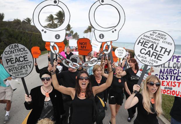 Protestors Call For Trump Impeachment Outside The President's Mar-A-Lago Estate