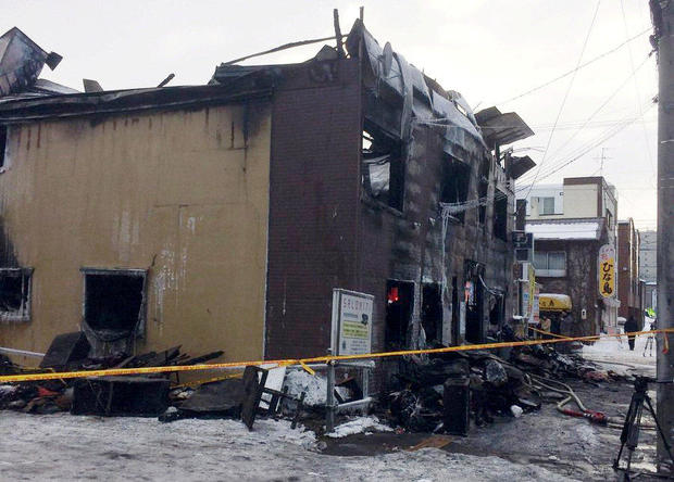 The charred exterior of a senior persons welfare facility is pictured in Sapporo, Hokkaido