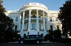 A vehicle pulls up in front of the White House to take U.S. President Barack Obama to Fort McNair for a game of basketball on election day in Washington