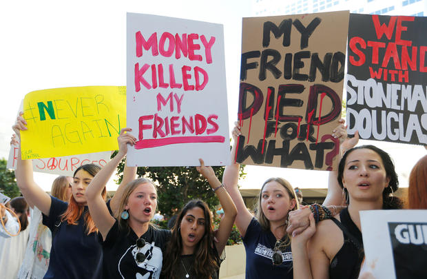 Demonstrators attend the March for Action on Gun Violence in Broward County at the U.S. Courthouse in Fort Lauderdale
