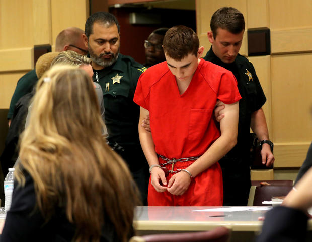 Nikolas Cruz, facing 17 charges of premeditated murder in the mass shooting at Marjory Stoneman Douglas High School in Parkland, Florida, appears in court for a status hearing before Broward Circuit Judge Elizabeth Scherer in Fort Lauderdale Feb. 19, 2018