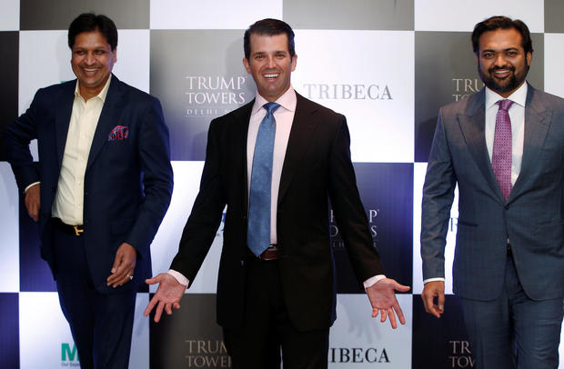 Donald Trump Jr. gestures as Basant Bansal, Chairman and Managing Director of M3M India and Kalpesh Mehta, founder of Tribeca Developers, look on during a photo opportunity before start of a meeting in New Delhi