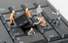 miniature people Work on Computer Keyboard