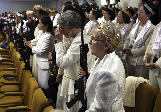 Worshippers clutching AR-15 rifles hold commitment ceremony at Wayne County church